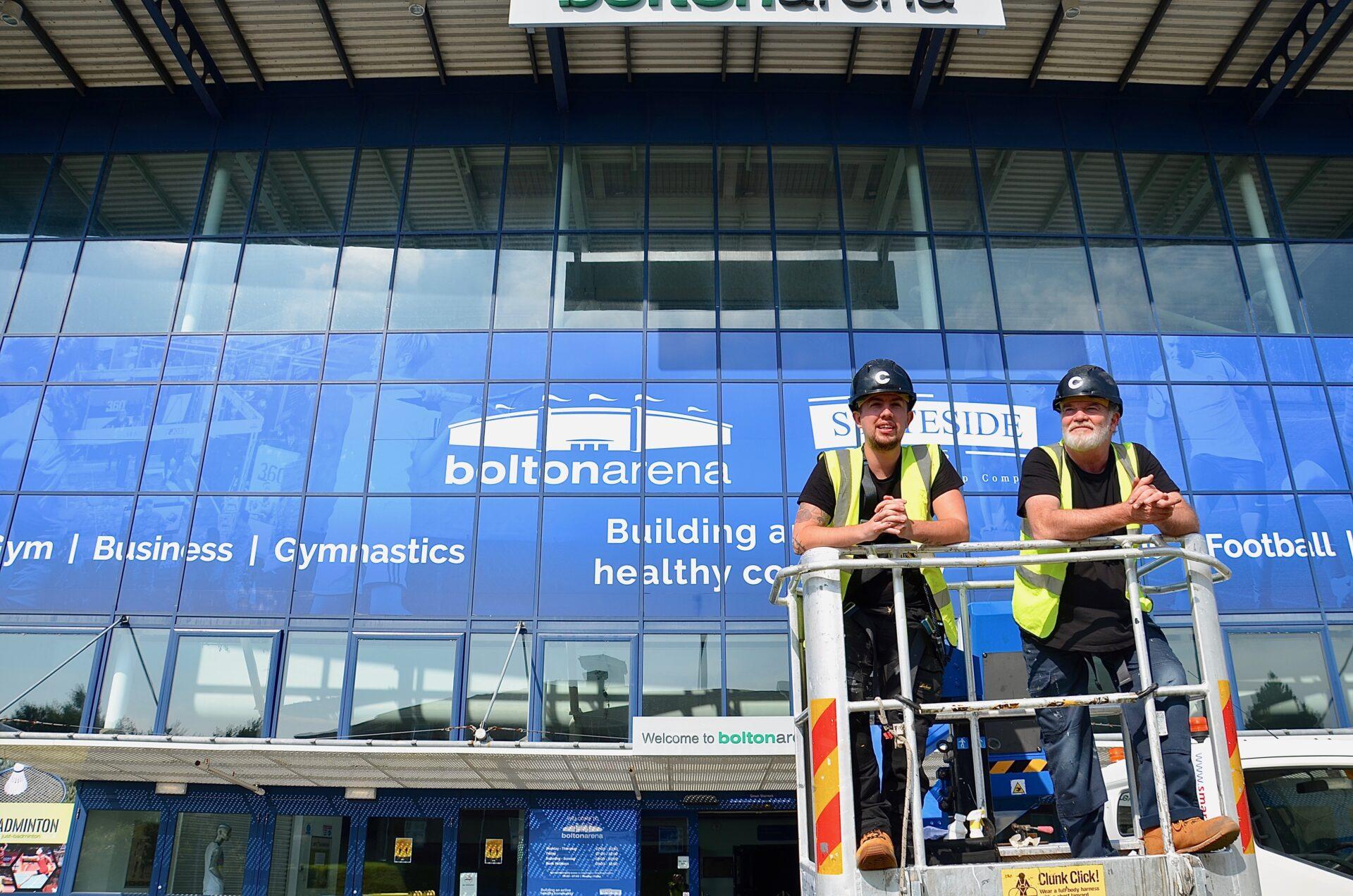Sam and Steve after Bolton Arena vinyl window application