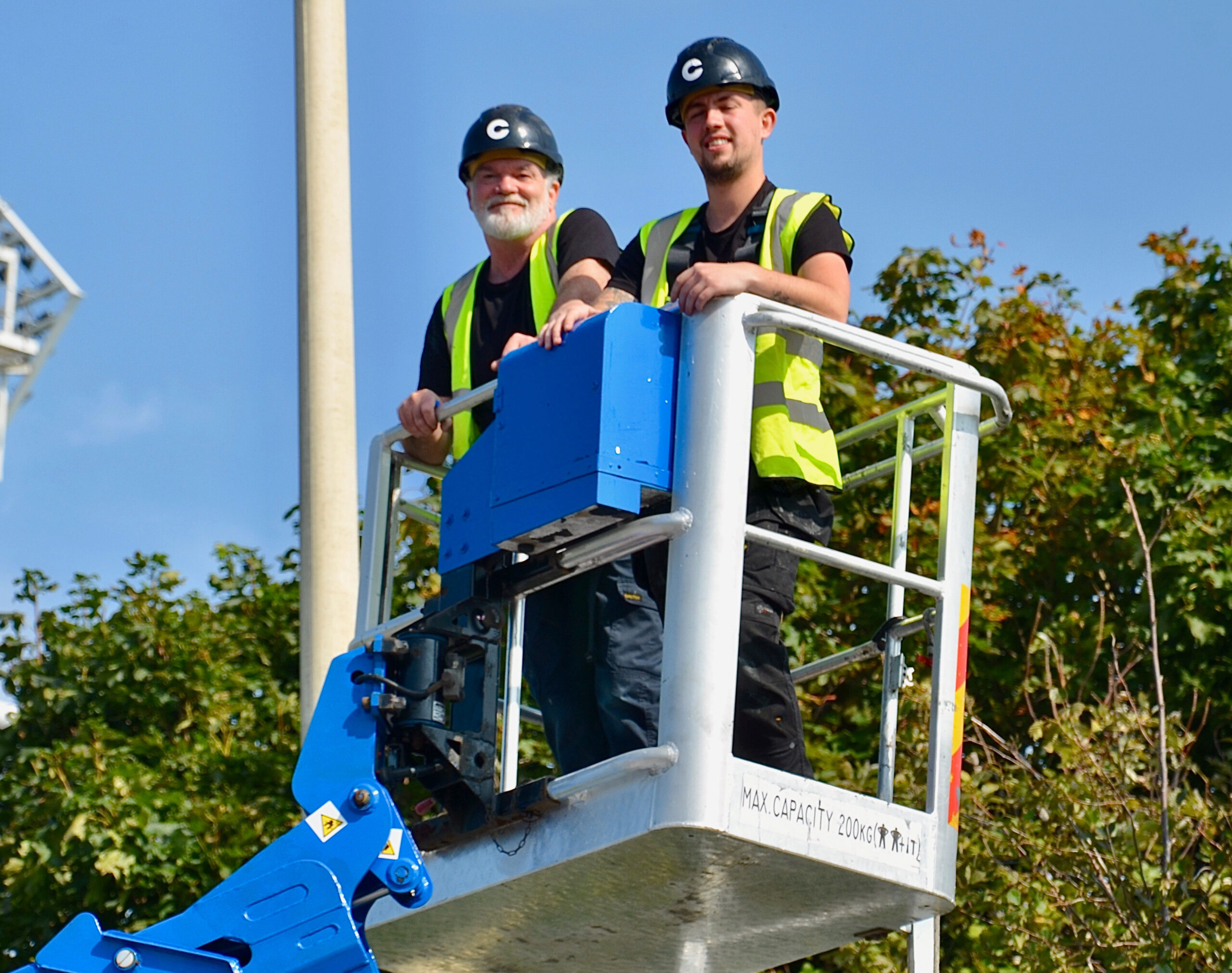 Sam and Steve from the print room department working on a cherry picker